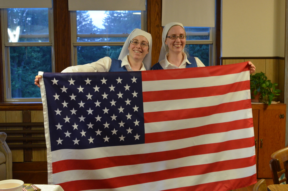 We always end evening recreation by singing the National Anthem. Sr. Danielle and Sr. Maria were appointed to be the official flag holders.
