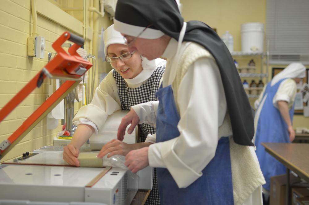 Sr. Maria Johanna teaches Sr. Mary Martin how to wrap soap!