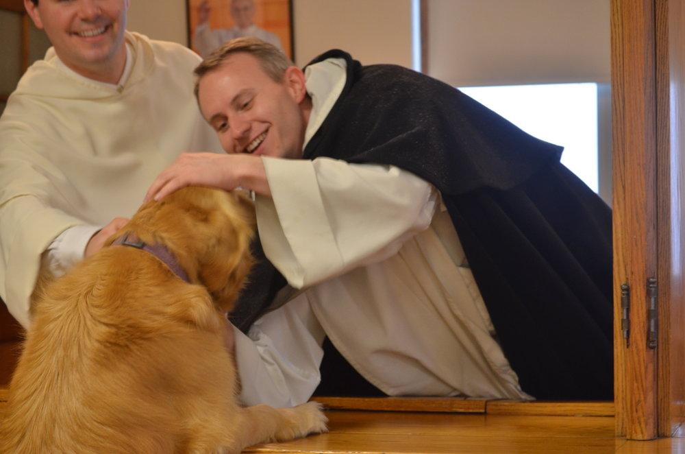 Sabina greets Fr. Patrick (L) & Fr. Philip Neri (R)