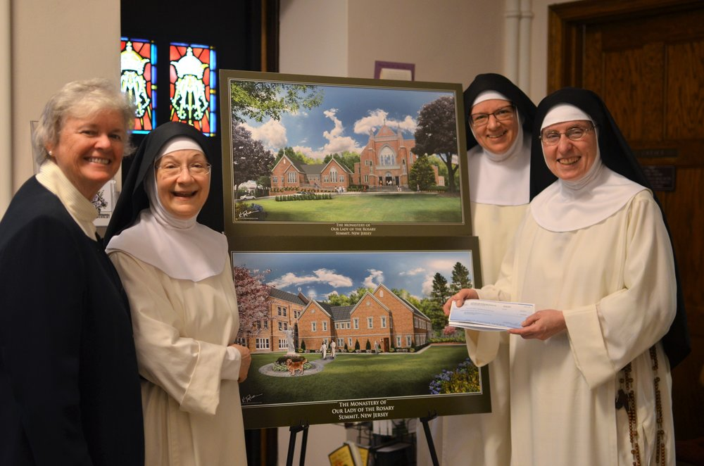 Sr. Patricia Codey, SC, Board Member of Support Our Aging Religious, presented the community with a $15K grant check for our new wing's handicap ramp.