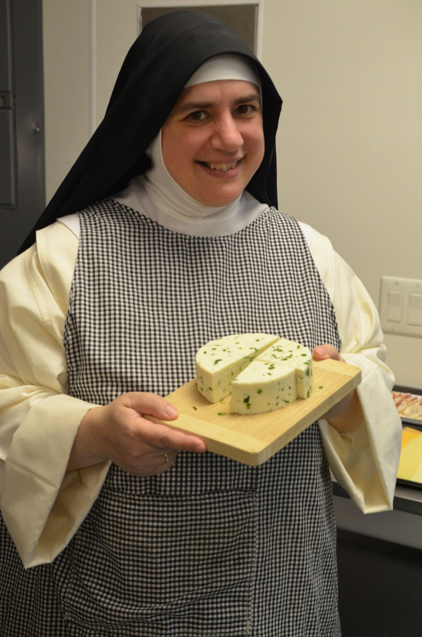 Sr. Mary Catharine shows off the Queso Fresco she made! It WAS delicious!