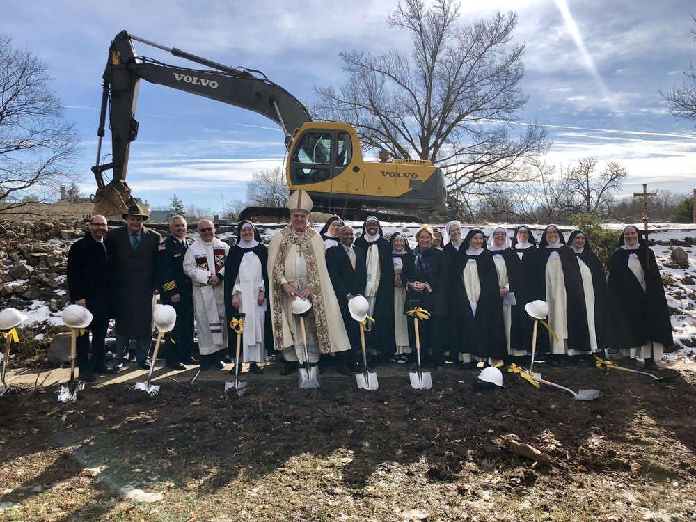 Most of the community with the guest dignitaries: (l. to r.) Justin Mihalik (architect), Bart Sheehan (monastery attorney), Summit Fire Chief Eric Evers, Msgr. Robert Meyer (pastor, St. Teresa of Avila Parish, Summit), Sr. Mary Martin (prioress), Cardinal Joseph W. Tobin, Sr. Judith Miryam, David Naidu (Summit City Council president), Sr. Mary Jacinta, Sr. Denise Marie, Mayor Nora Radest, Sr. Joseph Maria, Sr. Marie, Sr. Mary Veronica, Sr. Chiara Marie, Sr. Mary Ana, Sr. Maria Johanna, Sr. Mary Catharine, and Sr. Mary Magdalene. Photography by Ryan Cantwell, Hip New Jersey