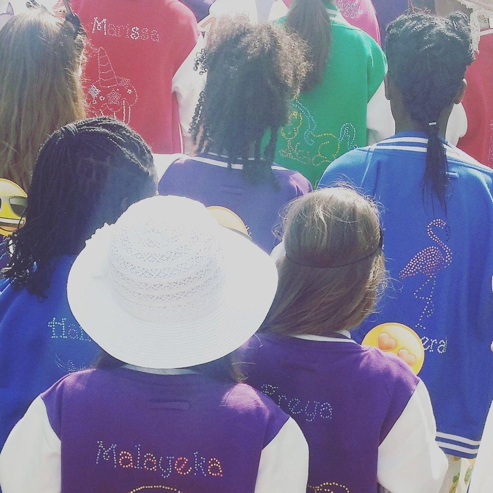 girls posing in their fashion jackets