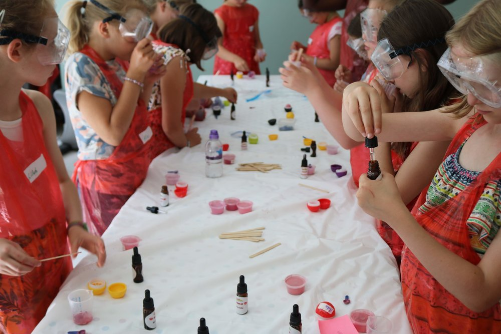 Girls making lip balms