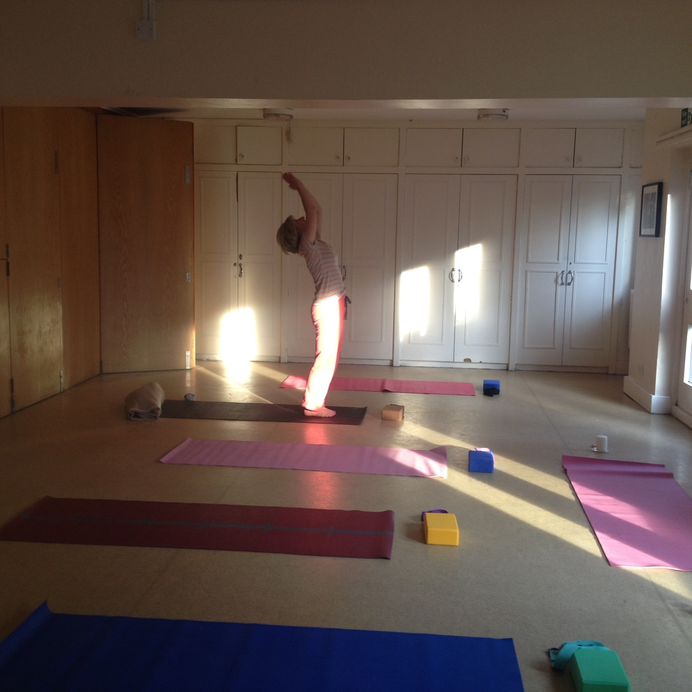 A student saluting the sun before class in our lovely bright studio at the Cambrian Centre