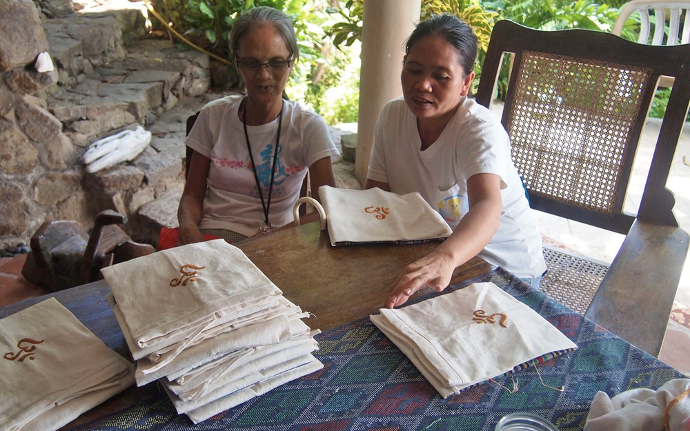 Aling Flora (left) does the hand embroidery for the Om Yoga Bags. Terry (right) is in charge of supervising production flow of the bags and quality control