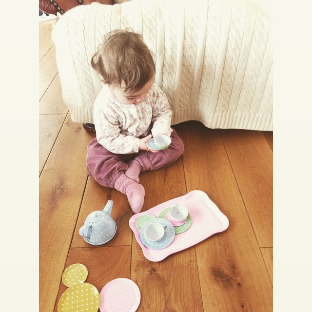 The youngest member of Pearls & Peonies grabbing a quick cup of tea in her favourite trio before a busy day begins #jojomamanbebe #littlewhitecompany #pearlsandpeonies