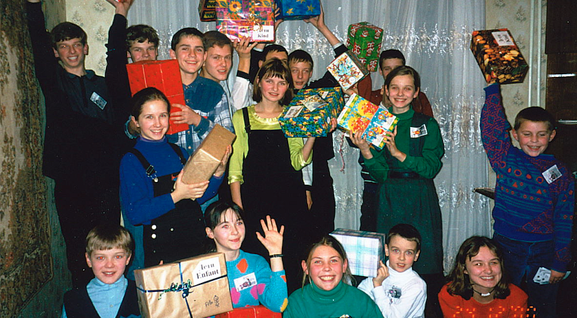 Nataliya's friends and family get ready to open their boxes from Operation Christmas Child.