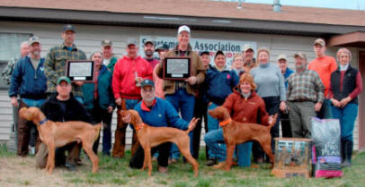 Derby Classic Winners:    Front Row: Jon Peck with Strider's Generator, Barry Peterson with Saginaw Diamond Dan, and Carol Burjan with Kal-Cam's Running Dozer    Standing: Kelley Hansen, Bill Linnig, Robert Tomczak (handler), Stella Lang, Jim Blumentritt, Ned Myers (judge), Greg Konan, Mike Kinler (judge), Mark Johnson (handler), Roy Pelton (Purina Rep), Daniel Burjan (handler), Kelley Hansen, Gordon and Tracy Long, Mr. Spacarelli, Mark Smith, Eric Ebert, and Bernadette Spacarelli.