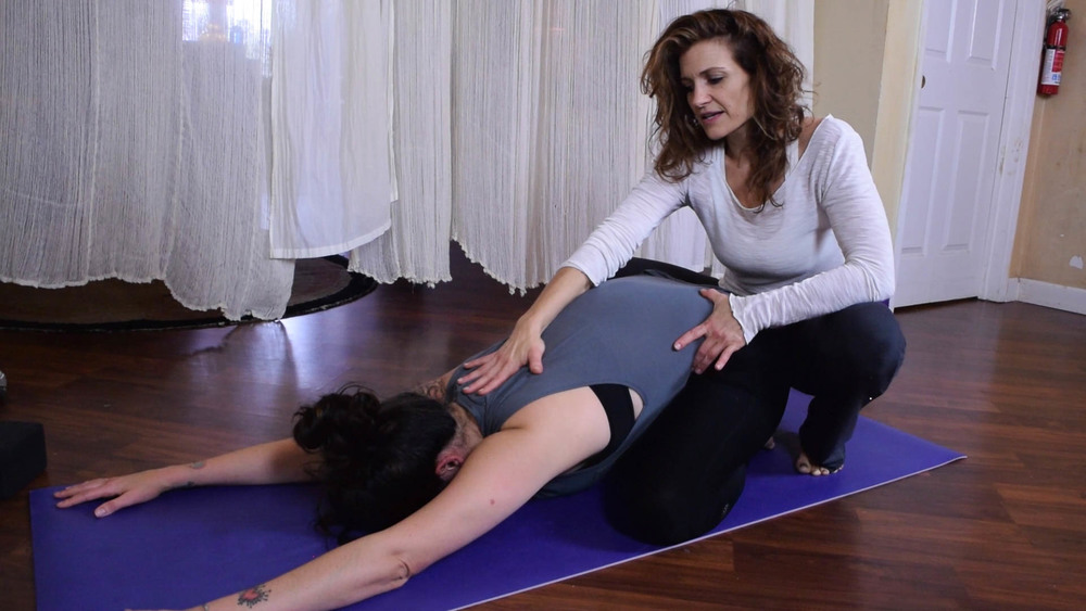 Jeannine Bush Clinton teaching hands on assists customized yoga Teacher Training