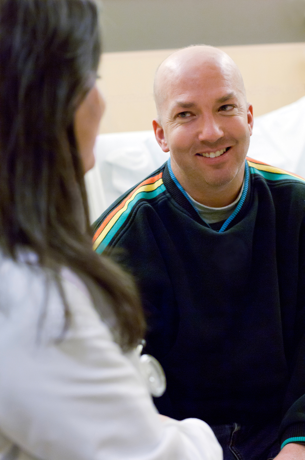 Cancer patient with treating physician, Fred Hutchinson Cancer Research Center