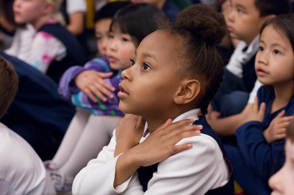 Kindergarteners practice a song