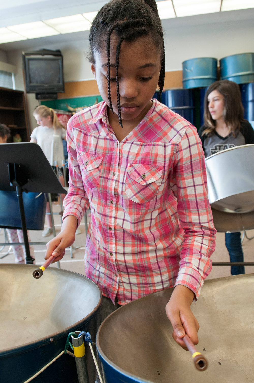 Students learn to play steel pans, Dance Daigre