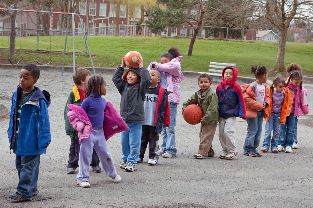 Kindergarteners line up after recess, The New School