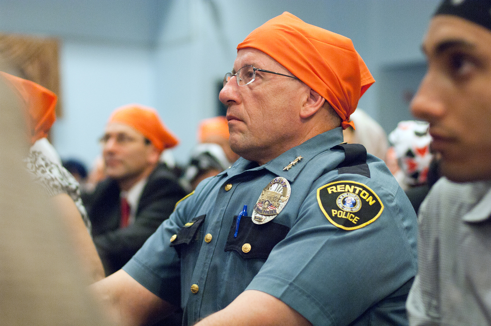 Members of the community attend a service and vigil to honor those killed at a Sikh temple in Wisconsin