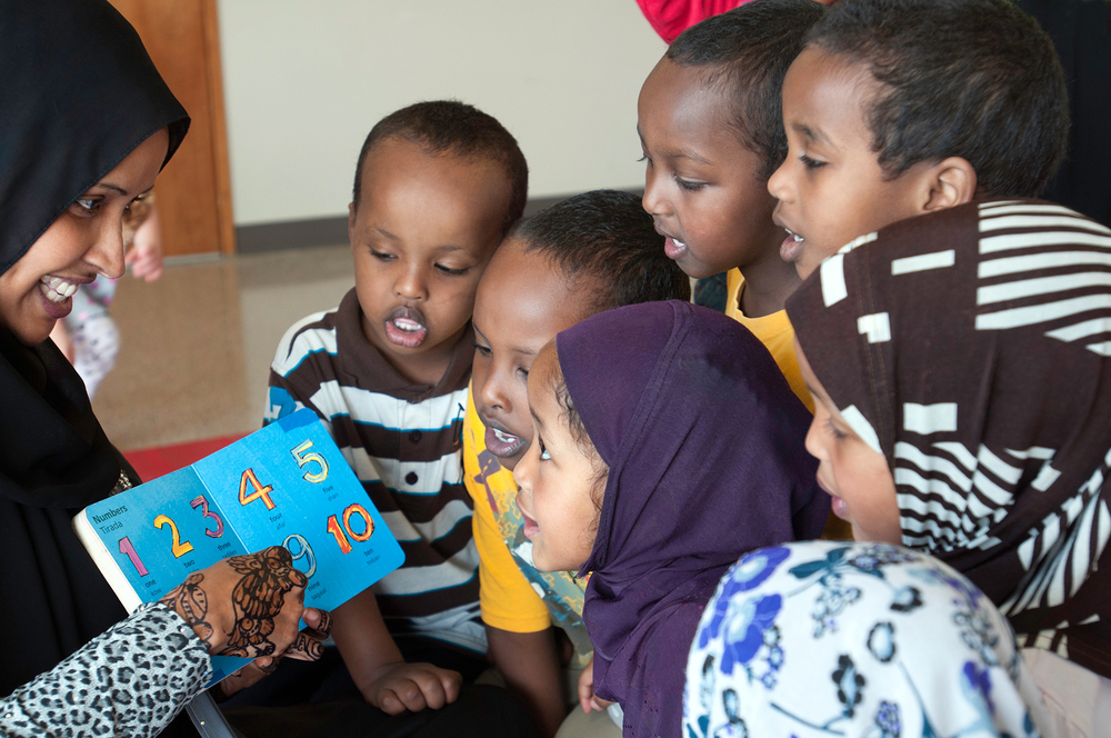 Preschool children from Somali community gather round the teacher eager to learn, Veteran & Human Services Levy