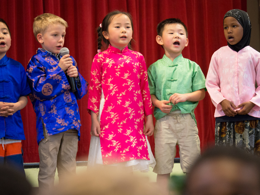 Mandarin immersion kindergarteners sing a Chinese song at multicultural school celebration