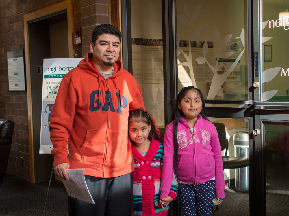 Father with his two daughters are on their way after a visit to neighborhood medical clinic, Neighborcare Health
