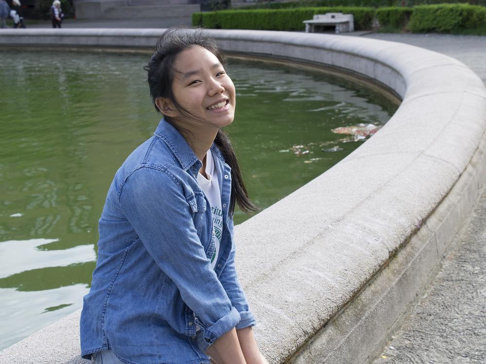 International student from China enjoys the University of Washington fountain landmark