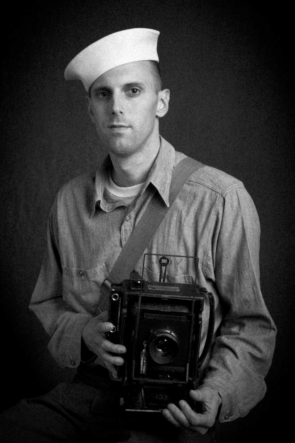 Me in my vintage World War II U.S. Navy Photographer's Mate impression with a period 4x5 Anniversary Speed Graphic camera.