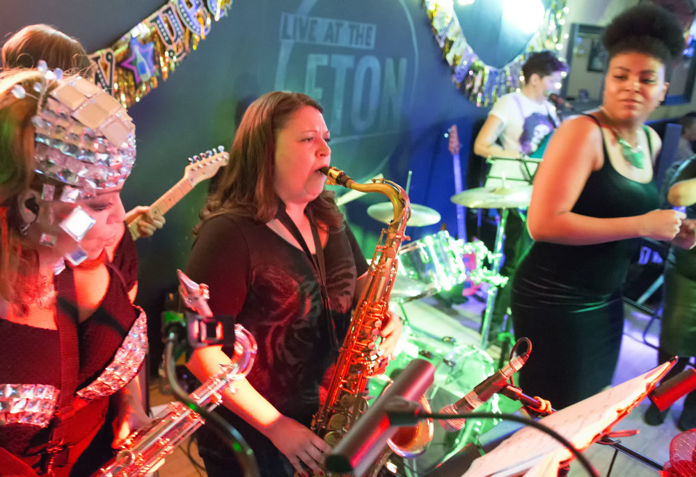 Sax section, Carrie and Elena, partial Aimee on guitar, Janelle all looking spectactular