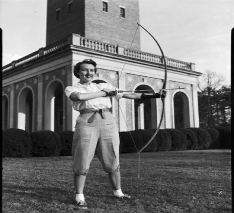 This young woman is happily showing off her new bow in front of the bell tower (Hugh Morton Collection)