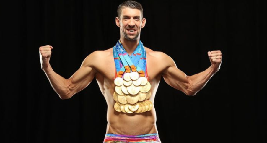 Michael Phelps with all 23 of his Olympic Gold Medals - A true champion who knew exactly what he had to do to execute when it came time to race.