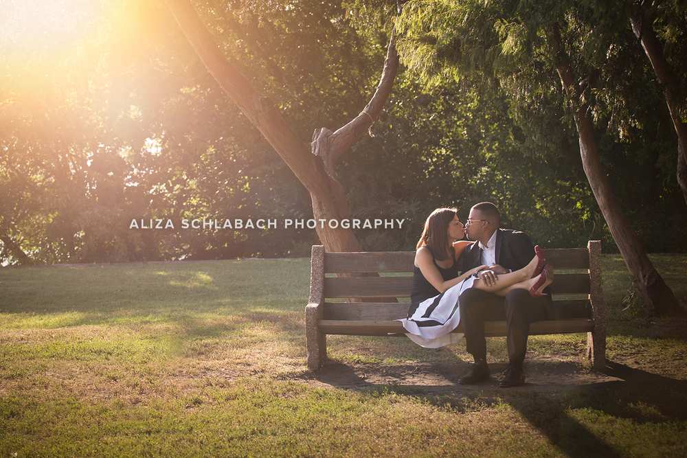 Golden hour portrait of a couple on a bench