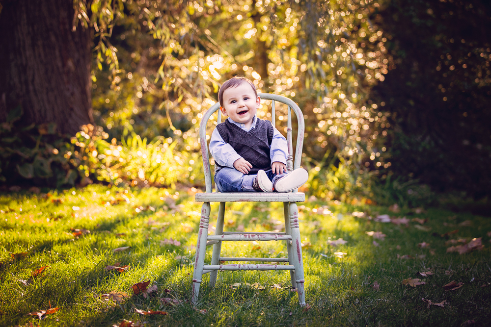 Outdoor fall portrait of a baby on an antique chair