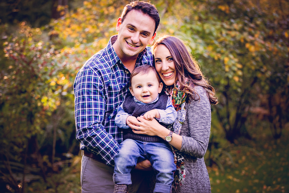 Fall portrait of a couple with their baby boy at Appleford Estate