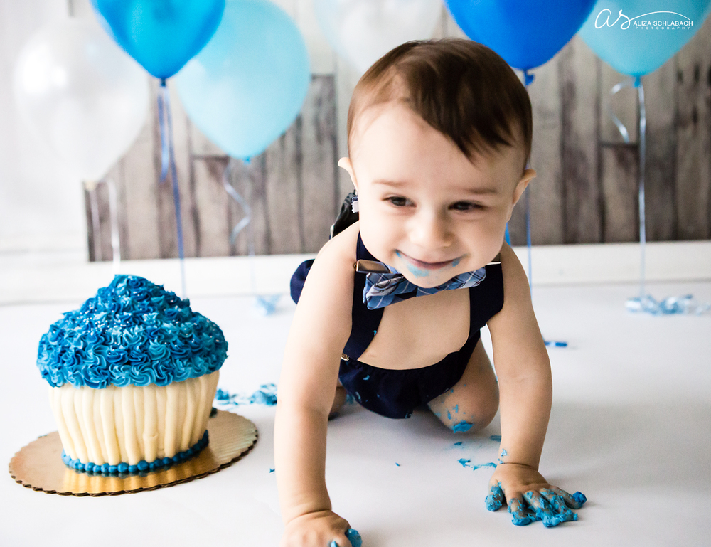 Crawling baby boy at his cake smash photo shoot