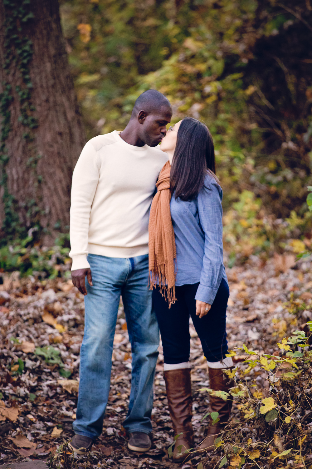 Fall photo of cute couple kissing