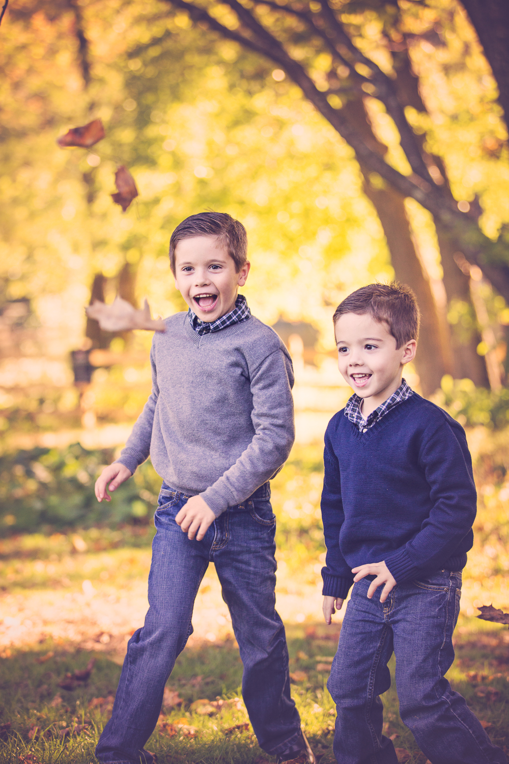 Fall photo of two brothers with autumn leaves