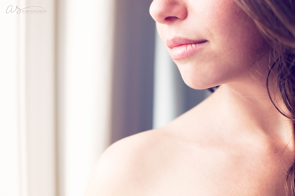 Young woman: bare shoulder and beautiful lips