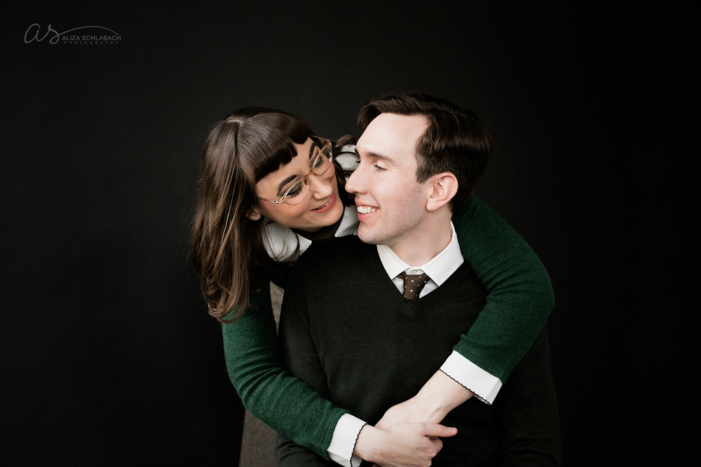 photo | girl with her arms wrapped around her fiancé | engagement portrait at Aliza Schlabach's Ardmore photography studio