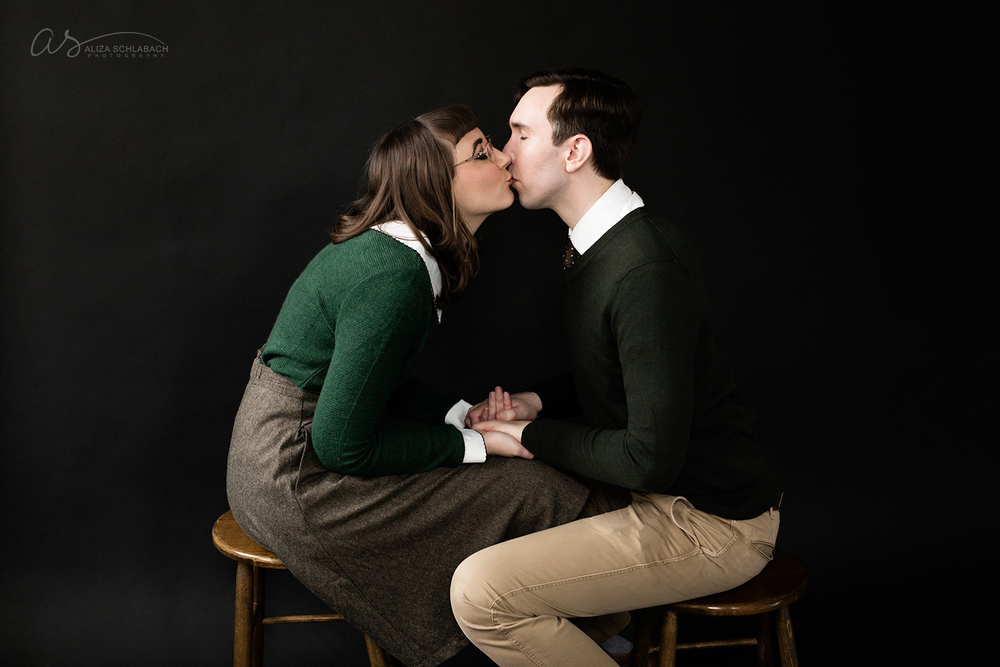 photo | sitting on stools and kissing | engagement portrait at Aliza Schlabach's Ardmore photography studio