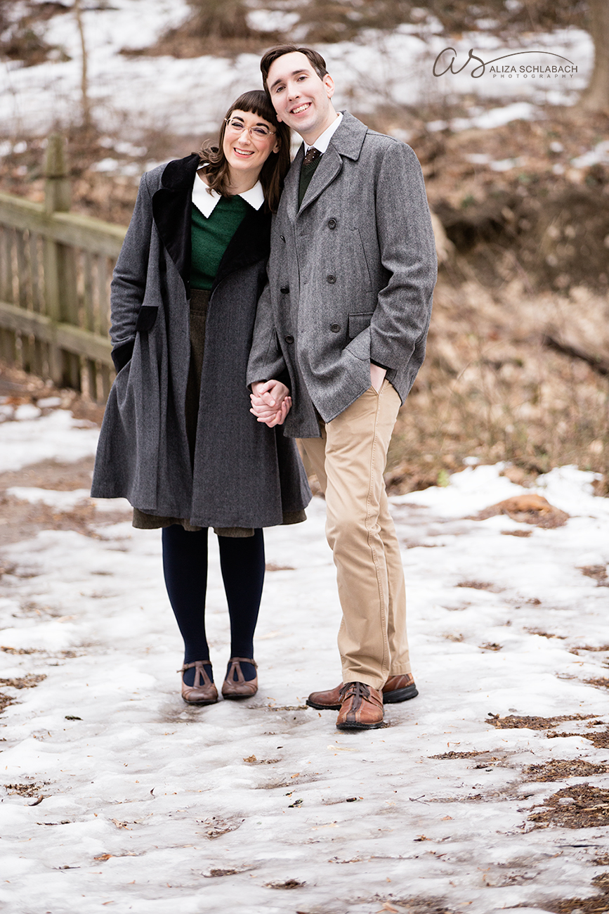 photo | snuggled up and holding hands | close up on a bridge | engagement portrait at Haverford College in winter