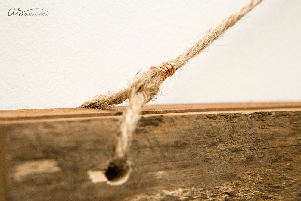 Detail photo of barnwood frame, twine, and copper wire