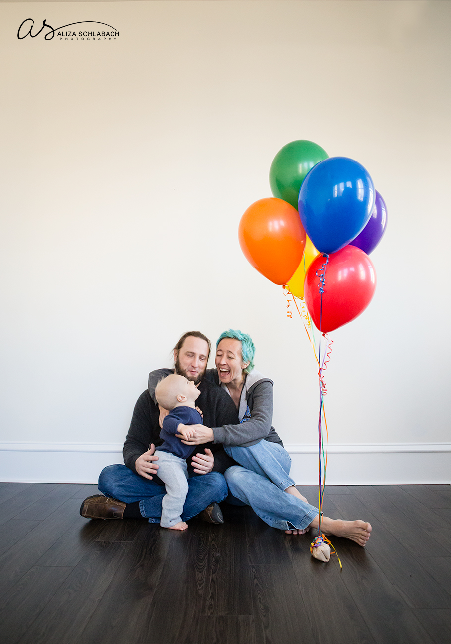 Photo of one year old boy, parents, and balloons