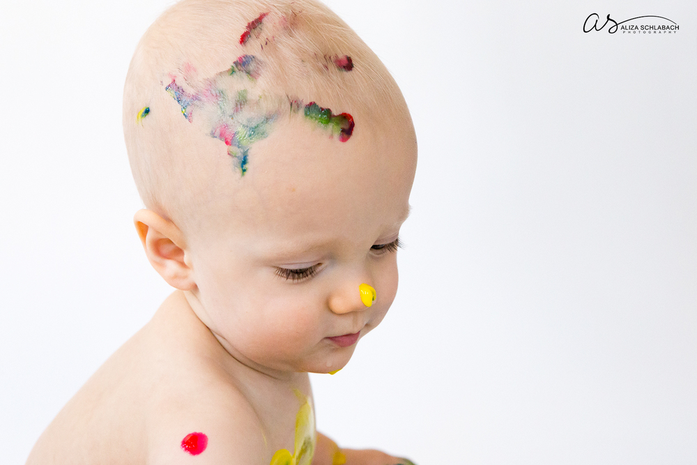 Photo of one year old boy with fingerpaint handprint on his head