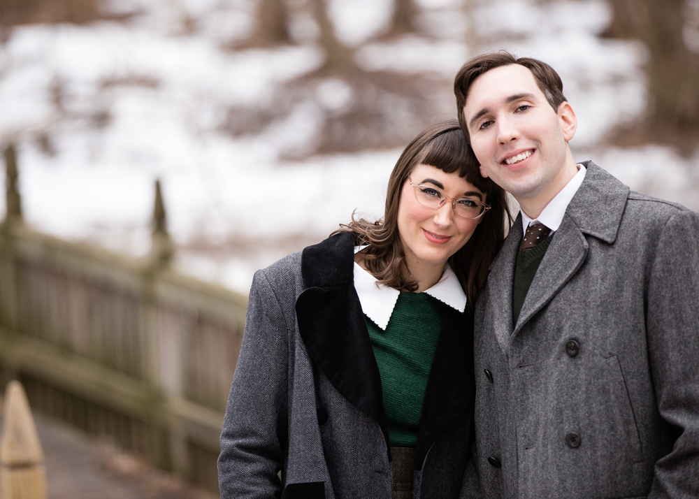 Photo of a vintage / retro looking young couple in the snow