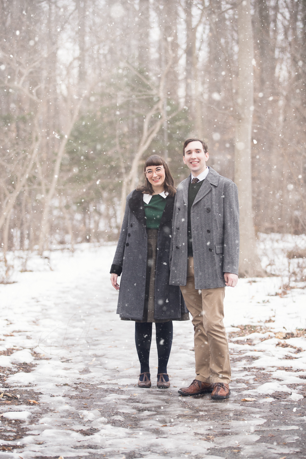Retro couple in the falling snow