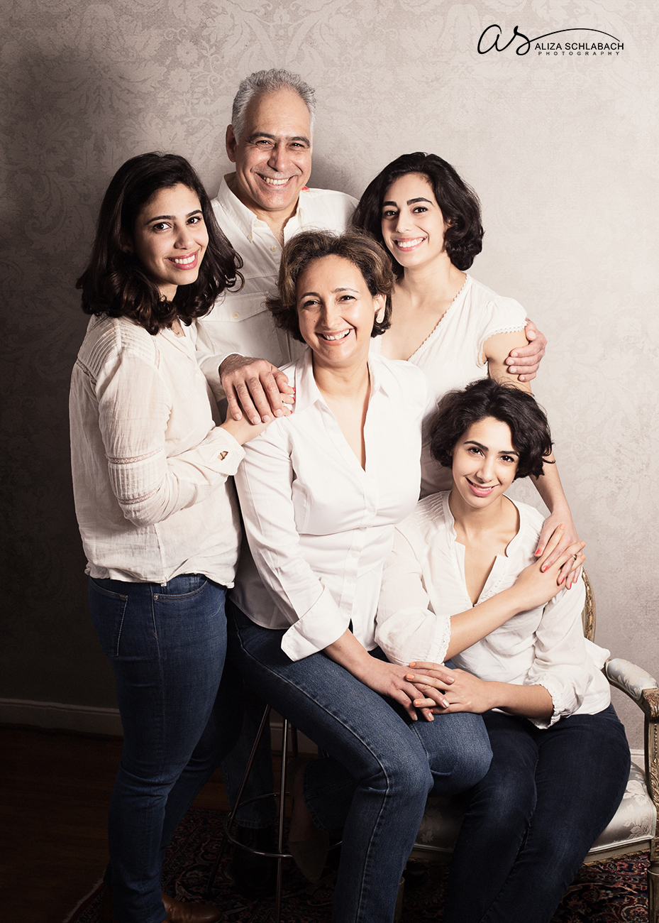 Family portrait of father, mother, and their three grown daughters