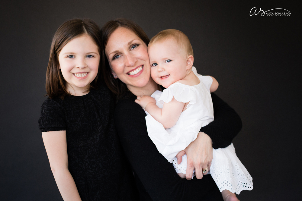 Family portrait of mother with her six and one year old daughters