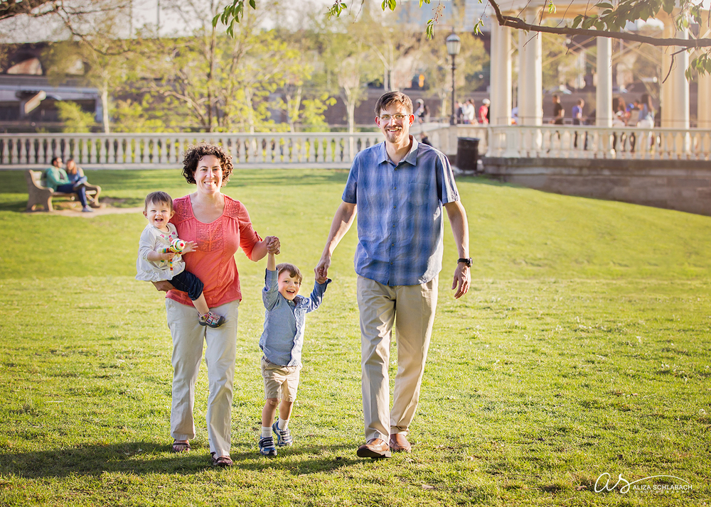 Family holding hands and walking by the Philadelphia Waterworks