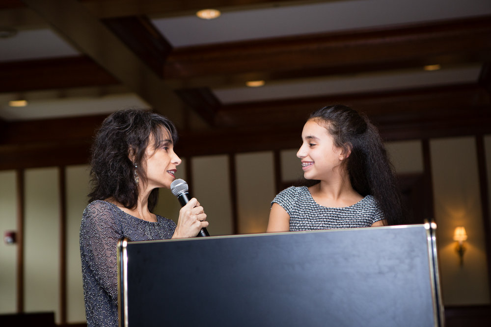 Photo of mother and daughter during bat mitzvah ceremony