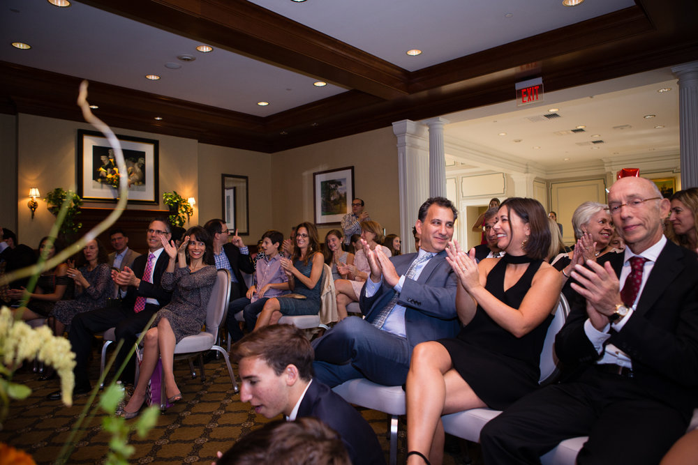Photo of clapping guests at conclusion of Bat Mitzvah speech