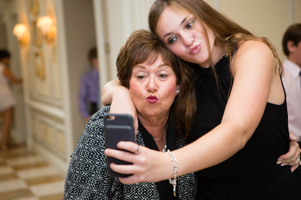 Photo of grandma and grandaughter taking a silly selfie