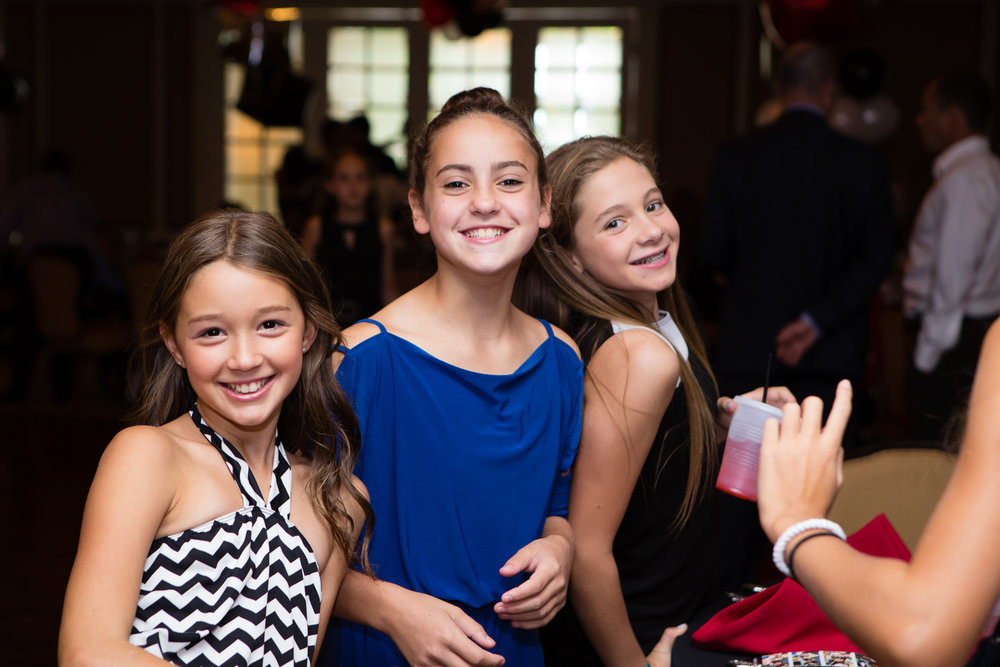 Photo of smiling girls at Bat Mitzvah ceremony