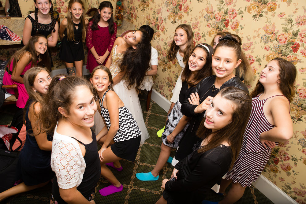 Photo from above of big group of girls at mitzvah